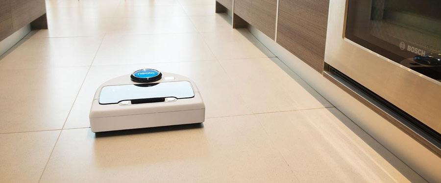 Neato Vacuum in a Kitchen