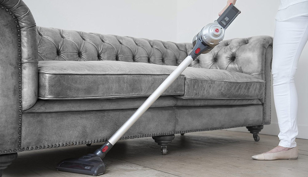 An example of a cordless vacuum cleaning underneath a sofa